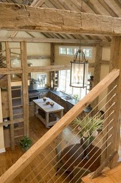 Stainless Steel cables offer nice juxtaposition to primitive hand hewn beams. M/D Pool House Barn.: