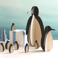 """Our 7"""" tall Tux is a wooden (2 piece) penguin that will make a terrific addition to your penguin collection, or a classic and crafty display at any penguin party or gathering. While this penguin may b"""