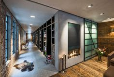 Design studio TANK transformed a conventional office space in Amsterdam, Netherlands, into a complete family home Brick Interior, Office Interior Design, Floor To Ceiling Bookshelves, Living Room Lounge, Living Rooms, Interiores Design, Modern Rustic, Future House, Ramen