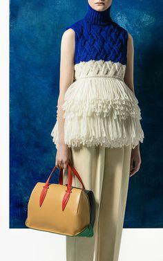 Delpozo sleeveless fringe knit top in Klein blue, with a colorblocked Delpozo doctor bag.