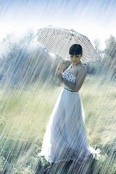 I would wear this outfit... I would walk in the rain wearing it... I would smile and enjoy it all..... Uh oh....just found out she's not really walking in the rain. I still like the shot though.....
