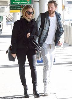 Glowing: The movie star pounded the pavement in heeled black boots while her bearded love walked besides her, wearing grey sweats, a white T-shirt, and a charcoal hued zip up jacket