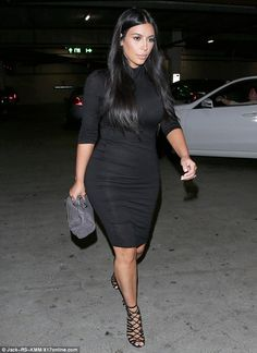 Indulging her pregnancy cravings: Kim Kardashian picked up lunch at Nate n' Al delicatessen in Beverly Hills on Tuesday