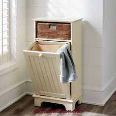 Great storage cabinet and hamper. Wood cabinet features one hand-woven banana leaf basket and a lower wainscot-detailed door with tilt-out laundry hamper with a fabric liner. Bathroom Furniture, Hamper Cabinet, Furniture, Laundry In Bathroom, Wood Cabinets, Bathroom Storage, Laundry Hamper, Storage, Tilt Out Laundry Hamper