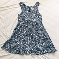 """Floral Baby Doll Tank Dress Worn once and still in amazing condition! No holes, rips, stains, etc. I'm 5'5"""" and it hits me about 3 inches above my knee. Zipper in the back stops at where the 3rd picture ends. Says size 7, but fits more like a 2 or 4, which is why I labeled it that way.  Looking to sell ONLY. NO TRADES.  Dresses"""