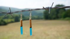 Hey, I found this really awesome Etsy listing at https://www.etsy.com/listing/469273123/blue-resin-and-wood-long-earrings-epoxy