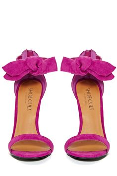 Hot pink bow heels.