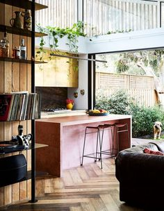 Modern kitchen with pink concrete kitchen island. I love the combination. If timber, white walls, black frames and the concrete. The Design Files - A Home Of Joy and Light, With Alex McCabe Of Kip&Co. Photo, Caitlin Mills