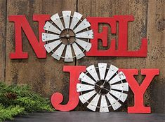 "KP Creek Gifts - Noel Windmill Metal Plaque. Perfect for the modern farmhouse - this style is available in two phrases. Includes a windmill accent in place of the letter ""O."""