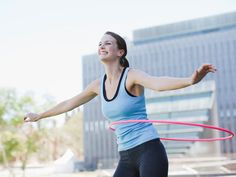 """Try Hula-Hooping: """"Put one foot in front of the other and push forward and backward on a diagonal toward the front foot,"""" says Hoopnotica Lead Master Trainer Jacqui Becker. """"Push harder and faster than you think is necessary and you will burn up to 600 calories per hour."""" #tone #tummy"""