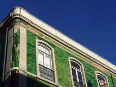 Lisbon, green tile facade by campagnoli, via Flickr