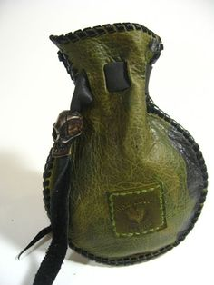 Leather Coin Bags What a nice edge you can make with leather lacing - and a little stitched label--