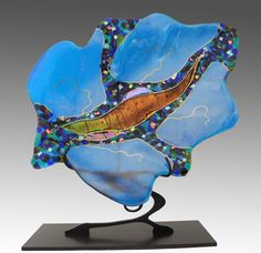 A luscious leaf with a mosaic design, makes for a stunning display on a custom stand. Large Turquoise Leaf on Stand by Karen Ehart. Art Glass Sculpture available at www.artfulhome.com