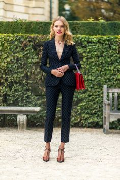 Natalia Vodianova in Dior. Polka dot makes suit more feminine. and red pop up in purse and lips even more. Oui Oui! Style from the PFW Street