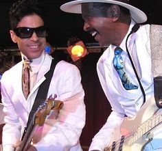 That;s right Prince jamming with Larry Graham Prince another in a long line of Bass players that adopted the slapping technique originated by Graham. Here opening for Prince in 2011 with Graham Central Station