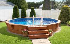 This pool's symmetrical contour will add a touch of finesse to your exterior decor and is sure to enhance your backyard. This pool's symmetrical contour will add a touch of finesse to your exterior decor and is sure to enhance your backyard. Above Ground Pool Landscaping, Backyard Pool Landscaping, Backyard Pool Designs, Small Backyard Pools, Outdoor Pool, Small Backyards, Small Pools, Landscaping Ideas, Small Above Ground Pool