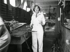 """May Bradford welding part of the all Australian monoplane for the England-Australia air race, 1934 / photographed by Sam Hood. May Bradford was the first woman pilot to hold """"A"""" & """"B"""" ground engineer's licences in Australia."""