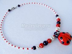 Cured beads from polymer clay Ladybug
