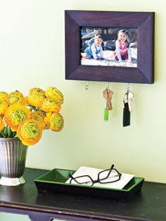Attach hooks to a picture frame to keep keys centralized.