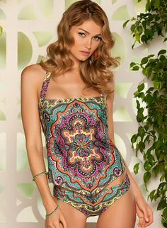 Halter style tankini with a straight across neckline, built-in shelf bra with removable cups. Side stays for added support and thick neck ties. The bodice of the tankini is unlined and has a relaxed fit.  Medium rise bottom with side tabs in a luxurious paisley print fabric. Fully lined and full back coverage by BECCA by Rebecca Virtue Swimwear, $132.00