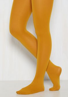 Accent Your Ensemble Tights in Curry. Add a pop of color to your day by pulling on these goldenrod tights! #yellow #modcloth