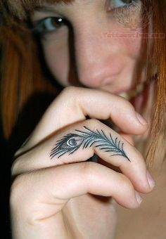 Peacock Feather Tattoo On Finger.... I must have this tatto maybe not on finger but I will have it!!!!!!!!