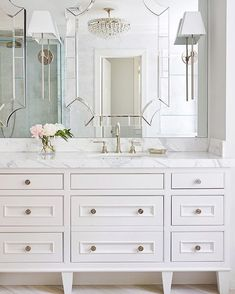 "Mirrored wall and furniture style vanity help ""open"" the bathroom."