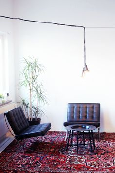 dark leather chairs, oriental rug | mix of modern & classical interior