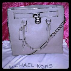 NWOT Large Michael kors Hamilton. MAKE ME A OFFER! New with out tags! No flaws, the feet aren't even scratched! Lol. It's a large gray with silver hardware and silver trim, Michael Kors Hamilton!   Feel free to make a offer on any of my item's!   BUY ONE GET ONE HALF OFF that's equal to or lesser than in value!   Trade value on some of my item's may be higher than listing price! Michael Kors Bags Satchels