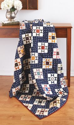 """We love our modern quilts, but Liz Porter's design is testament that traditional quilts continue to inspire. The hourglass units are a snap to make using  """"no triangles"""" method."""