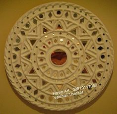Kutchi lipan work is an ancient mural art of kutch.It used to be done into huts to decorate it.The material to do this work was cow-dung. Clay Wall Art, Mirror Wall Art, Mural Wall Art, Mural Painting, Hanging Wall Art, Paintings, Murals, Mirror Crafts, Clay Art Projects