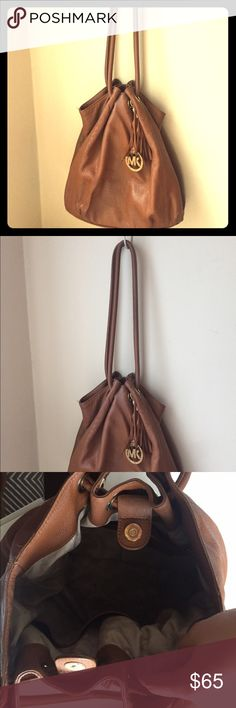 Michael Kors Brown Satchel Bag In great shape besides the tarnished leather on the back bottom (pictured). A very stylish/casual purse! Michael Kors Bags Satchels