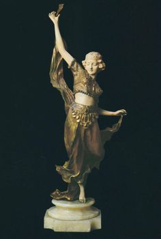 An Art Nouveau Bronze and Ivory Dancer.