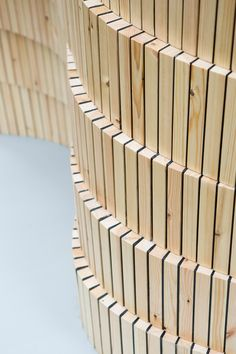 Dutch designer David Derksen's Wallwood sculpture is made from rectangular slices of wood that have been sandwiched together with resin to create a rippling wooden partition