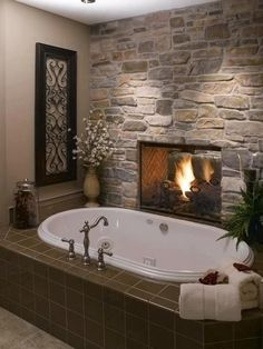 Install a two-sided fireplace between the bathroom and the bedroom. Who needs heated tiles when you have a bathroom fireplace? Dream Bathrooms, Beautiful Bathrooms, Master Bathrooms, Luxury Bathrooms, Master Baths, Master Tub, Romantic Bathrooms, Marble Bathrooms, Romantic Master Bedroom Ideas