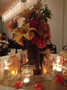 If the centerpieces were pale color roses and if the mason jars were blue