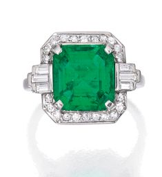 PLATINUM, EMERALD AND DIAMOND RING Centered by a square emerald-cut emerald measuring approximately 10.4 by 10.2 by 6.0 mm, framed by baguette and single-cut diamonds weighing approximately .50 carat, size 7¼; circa 1925.