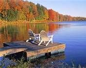 I want to be sitting in those chairs and on that dock in the Adirondack Mountains