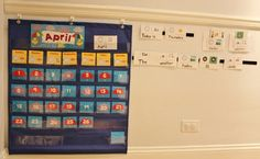 Semi-homemade preschool style calendar area, including homemade word cards that feature AAC symbols.