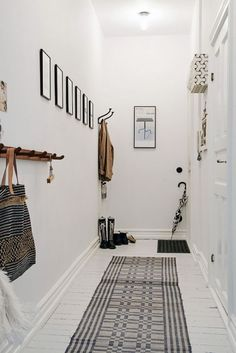 Black and white entry with geometric rug