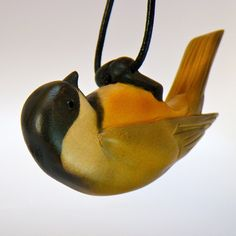 Black-capped Chickadee Wood Carving. via Etsy.