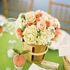 Pretty Peach Centerpiece - Wedding Table Centerpieces - Southernliving. An arrangement of peach-colored roses and white hydrangeas pay homage to the classic Southern fruit and reinforce the wedding's theme.