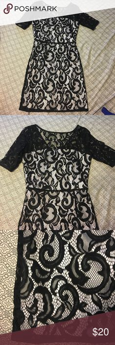 Black and white lace dress Black and white lace dress worn one time for my bridal shower Venus of Cortland Dresses Midi