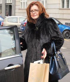 Classy lady in black mink coat.