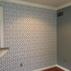 Grey grand trellis peel and stick wallpaper creates a feature wall