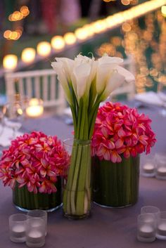 are those pink flowers orchids? Absolutely gorgeous. I adore how they are arranged as well.