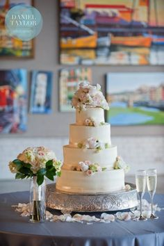Pastel wedding cake topped with flowers from Olexa's in Birmingham. Daniel Taylor Photography