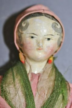 outstanding antique wooden Grodnertal doll with baby and original sleigh 1820-30