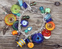 Lampwork Glass and Silver Charm Bracelet by seespotrun5 on Etsy, $55.00