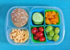 Whole Wheat Pita, Cucumber Slices, Mandarin Orange Sections, Green Grapes, Grape Tomatoes and Pimento Cheese.